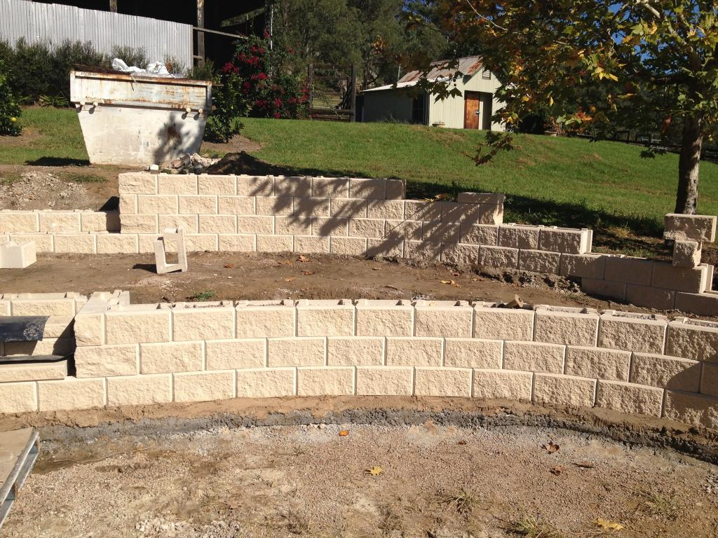 Retaining walls-St Pete FL Outdoor Living & Designs-We offer Landscape Design, Outdoor Patios & Pergolas, Outdoor Living Spaces, Stonescapes, Residential & Commercial Landscaping, Irrigation Installation & Repairs, Drainage Systems, Landscape Lighting, Outdoor Living Spaces, Tree Service, Lawn Service, and more.
